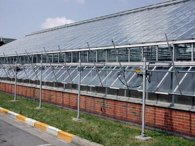 Photo of a greenhouse showing vents.